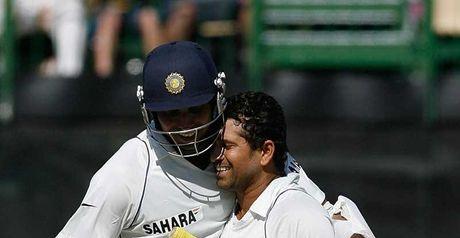 Tendulkar celebrates his century with VVS Laxman