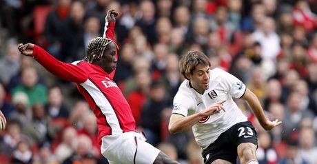 Sagna and Dempsey challenge the ball