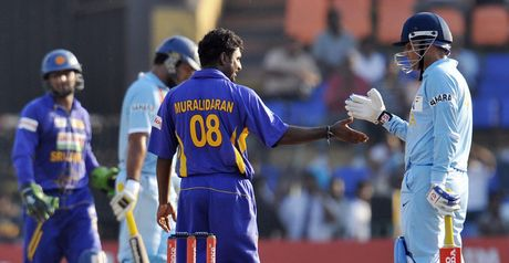 Muralitharan is congratulated after taking his record-equalling 502nd ODI wicket