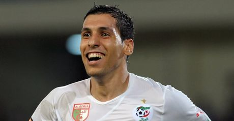 Algeria progress at expense of favourites