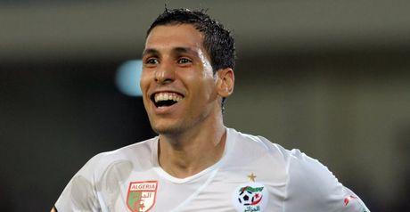 Algeria progress at expense of favourites