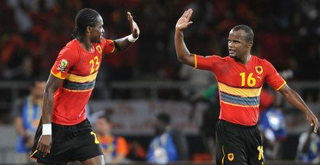 Angola players celebrate