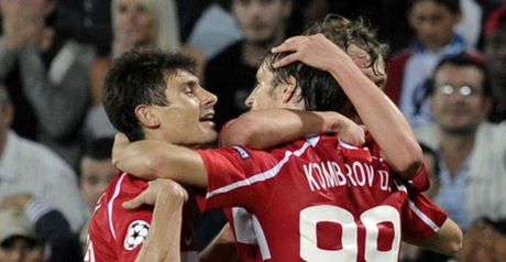 Goal joy: Dmitri Kombarov (right) celebrates with team-mates after his cross results in a Marseille own goal.