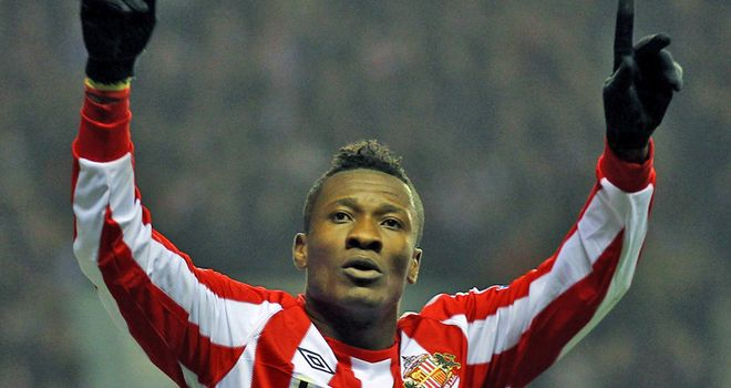 Gyan: Celebrating after scoring against Spurs