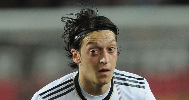 Ozil: Scored a hat-trick as Germany became the first team to qualify for Euro 2012 after thrashing Austria 6-2