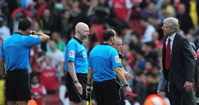 Arsene Wenger (right): The Arsenal manager feels referees would benefit with video technology