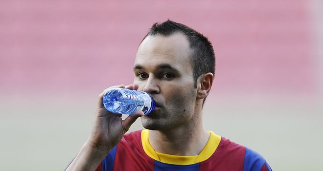 Iniesta: Faces a spell on the sidelines following muscle tear