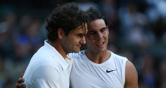 Federer and Nadal embrace after a titanic battle in darkening skies