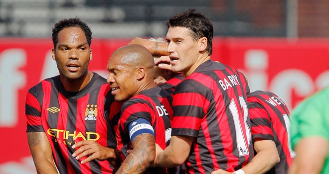 City players celebrate scoring against Club America