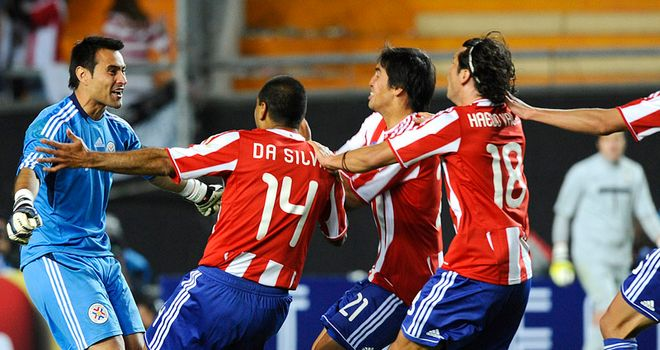 Paraguay's players celebrate their shoot-out win over Argentina