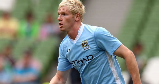 Ryan McGivern: Bristol City are in talks with Manchester City over a permanent deal for the defender