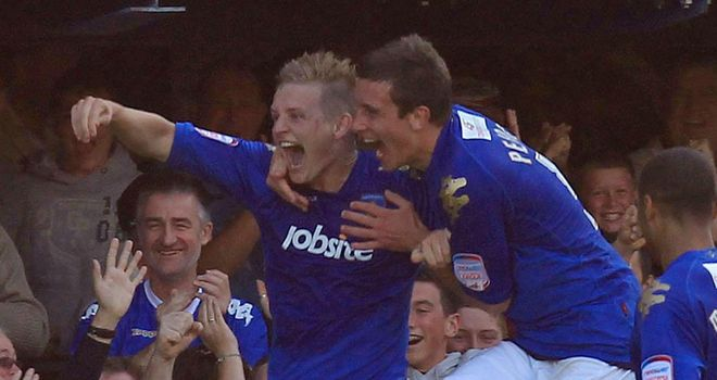 Huseklepp: Celebrates his last-gasp winner against Blackpool