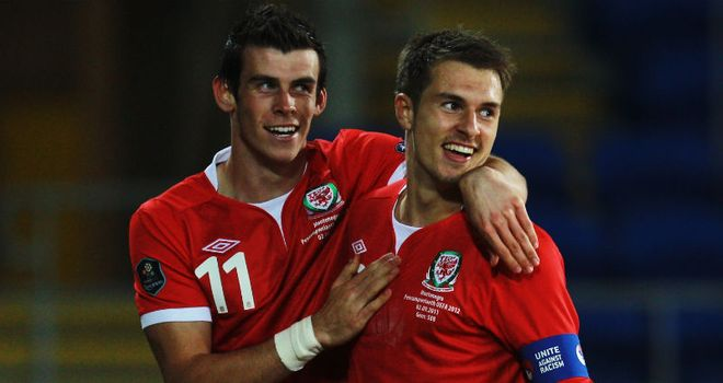 Goal: Aaron Ramsey celebrates with Gareth Bale after netting Wales' second goal against Montenegro