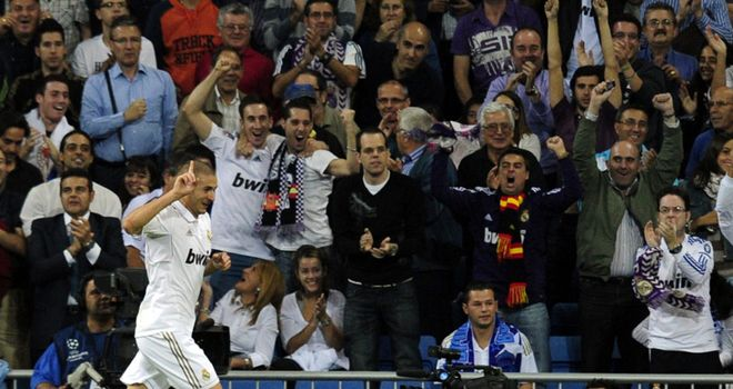Karim Benzema: Celebrates putting Real Madrid ahead in the 18th minute against Lyon