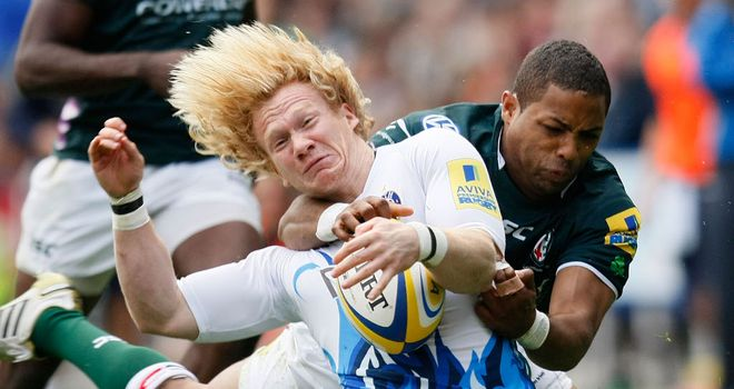 Delon Armitage (R) tackles Bath's Tom Biggs during the Aviva Premiership clash last month.