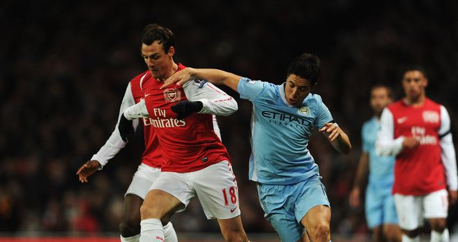 Samir Nasri: Manchester City midfielder has been told he can improve after being booed by Arsenal fans