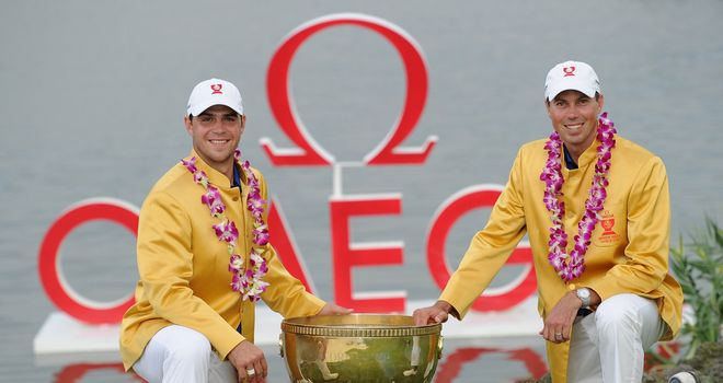 American dream team: Woodland (left) and Kuchar claimed the World Cup trophy