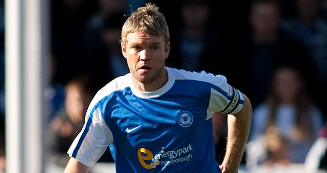 Grant McCann: Peterborough captain could be out for 10 weeks after suffering a knee injury