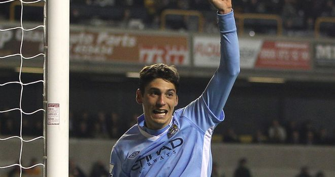 Scapuzzi: On loan from City