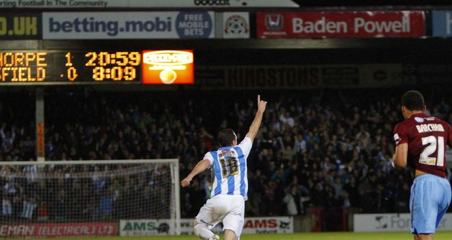 Tommy Miller: Has helped Huddersfield to stretch their unbeaten run to 41 games