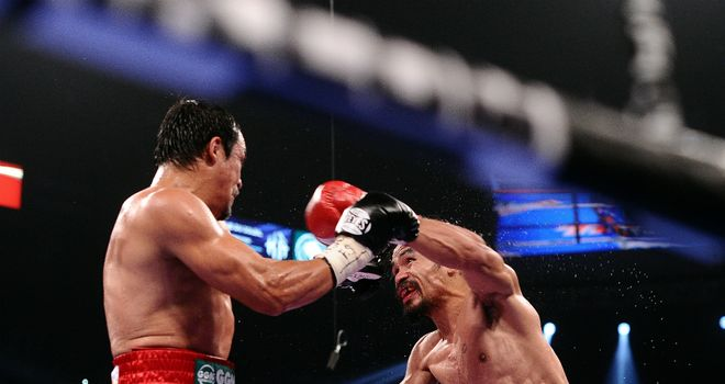 Manny Pacquiao and Juan Manuel Marquez fighting in Las Vegas in November 2011