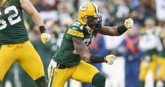 Mr Consistency: Charles Woodson (right) is Green Bay's backfield rock