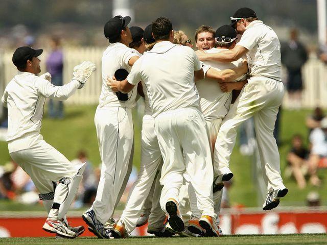 NZ hero Doug Bracewell is mobbed.