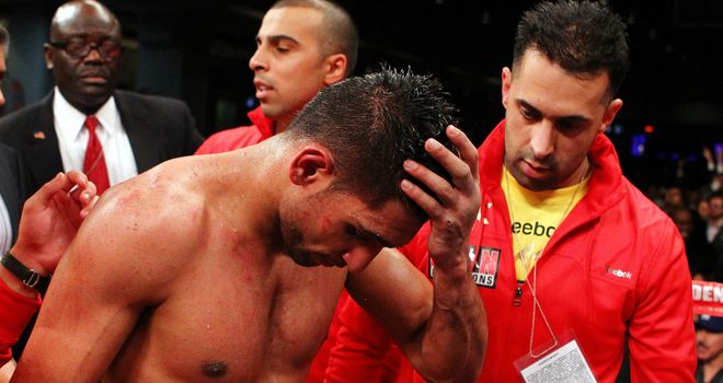 Amir Khan shows his disappointment after losing his WBA and IBF light-welterweight titles