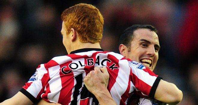 John O'Shea: The Sunderland defender lifts aloft Jack Colback after the midfielder's goal against Everton