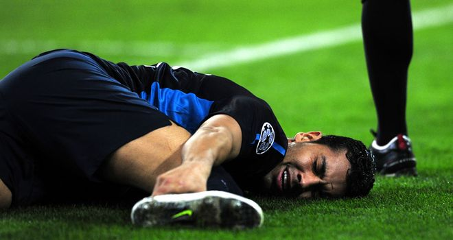 Andre Santos: Wenger admits his selection at Olympiacos was a gamble that backfired after the full-back suffered ankle ligament damage