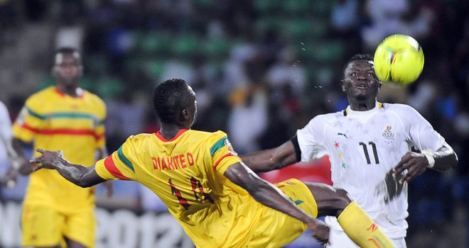 Sulley Muntari challenges for the ball for Ghana