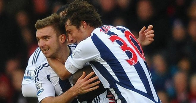 James Morrison: The Albion midfielder celebrates after firing the visitors ahead at Stoke