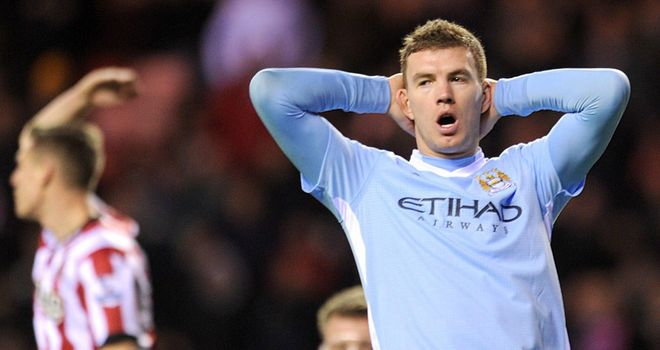 Edin Dzeko: Agent claims he would love to play for AC Milan and that it is a strong possibility