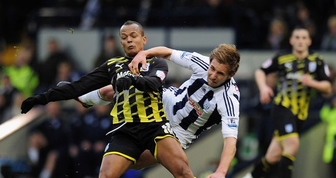 Robert Earnshaw tangles with West Brom defender Craig Dawson