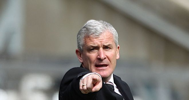 Mark Hughes: Planning to bolster his ranks, but is reluctant to name his targets