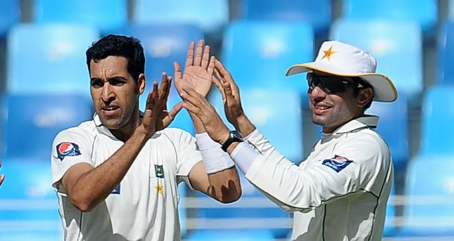 Umar Gul and Misbah-ul-Haq celebrate the fall of another England wicket on day three in Dubai