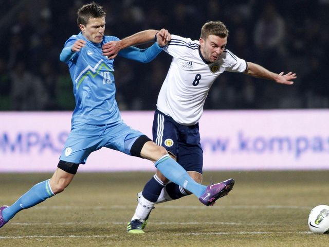 Ilicic and Morrison battle for the ball