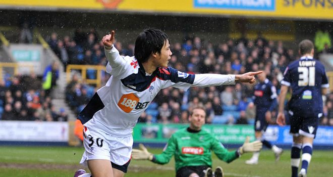 Ryo Miyaichi scores the opening goal of the game for Bolton at Millwall