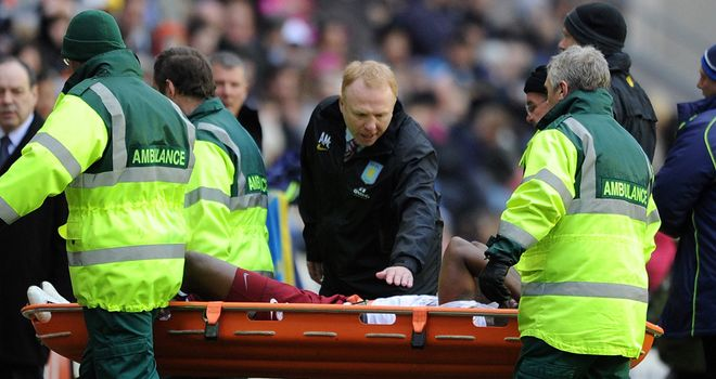 Darren Bent: Aston Villa striker stretchered off at Wigan