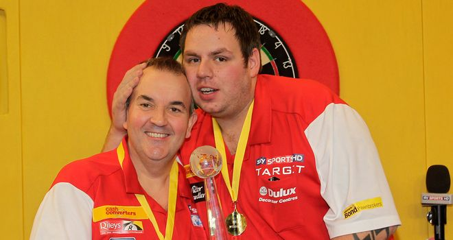 Champions: Phil Taylor and Adrian Lewis