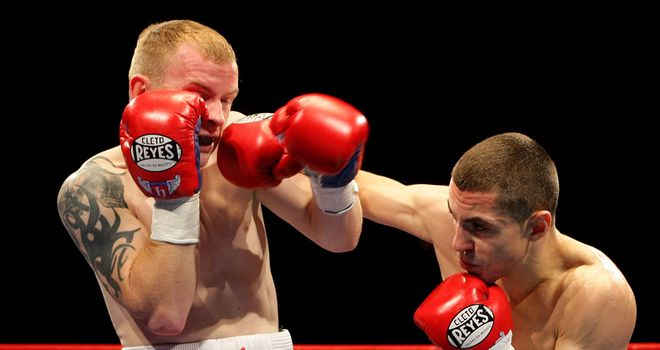 Recovery: Quigg (right) showed his battling qualities against Arthur