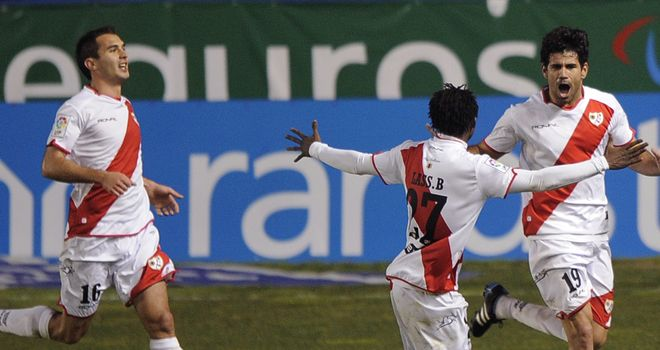 Rayo Vallecano players celebrate after staying up in the Primera Liga