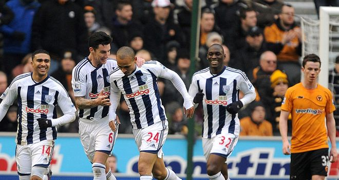 West Brom celebrate after Peter Odemwingie's hat-trick inspired an emphatic victory