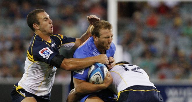 James Stannard is stopped in his track by the Brumbies