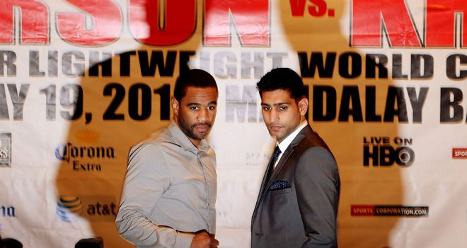 Lamont Peterson and Amir Khan getting re-acquainted in London