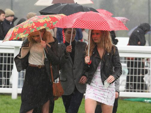 Sandown racegoers take shelter