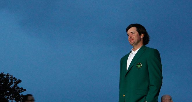 A cut above: Watson, resplendent in his new green jacket, poses for the photographers