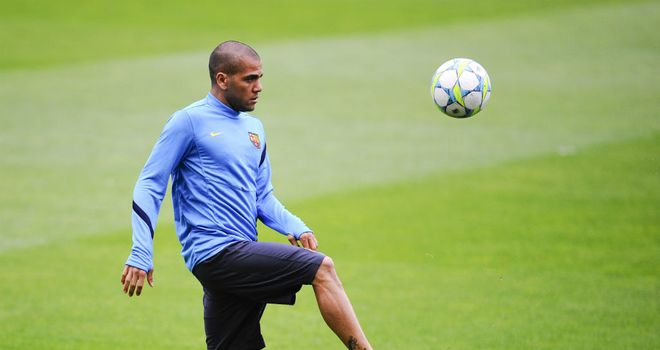 Dani Alves: Has ended speculation regarding a move to Manchester City by committing his future to Barcelona