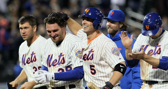 Daniel Murphy is mobbed by team-mates after the Mets win again