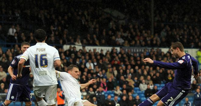 Steven Davies  scores for Derby on a miserable afternoon for Leeds